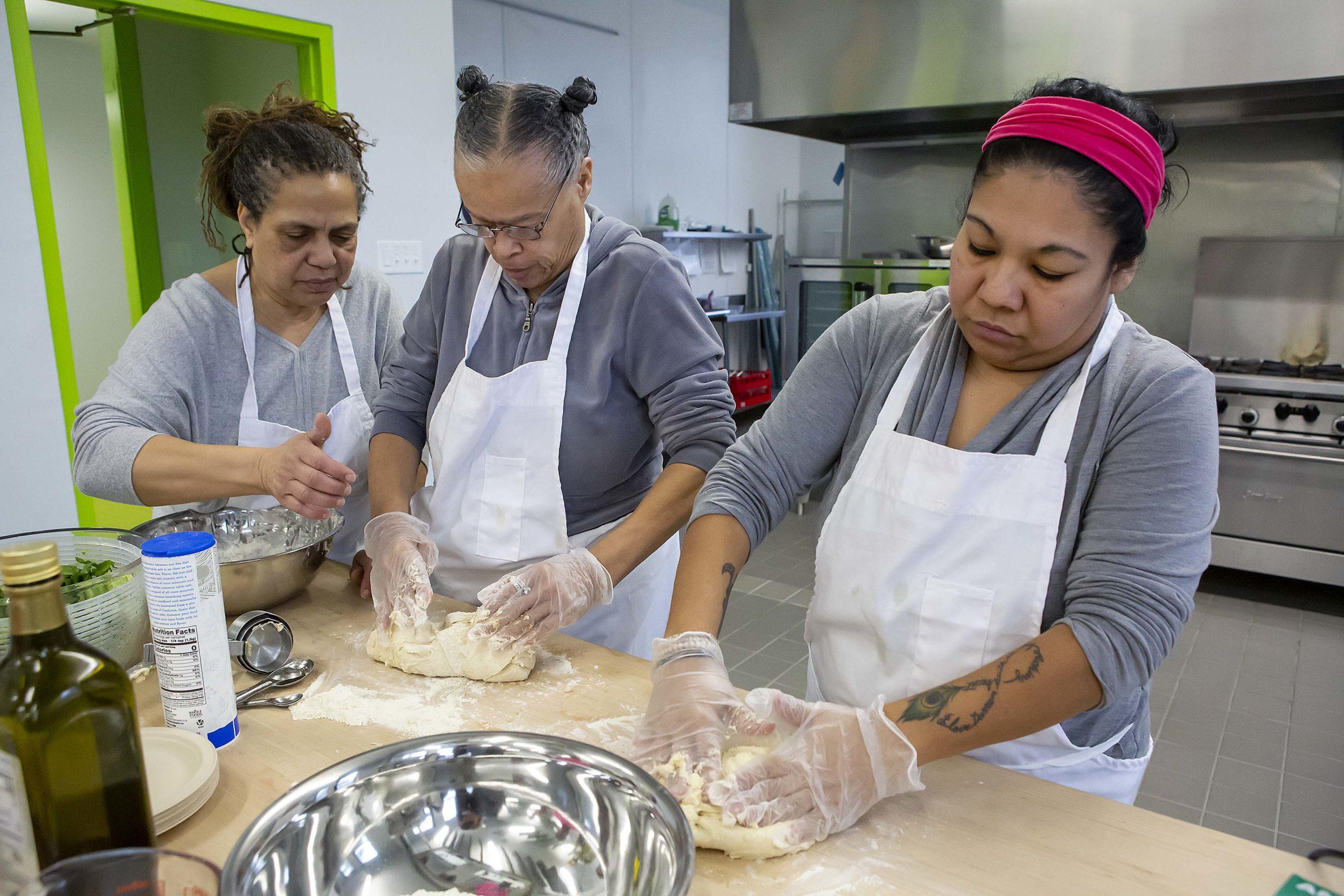 three women working in the kitchen