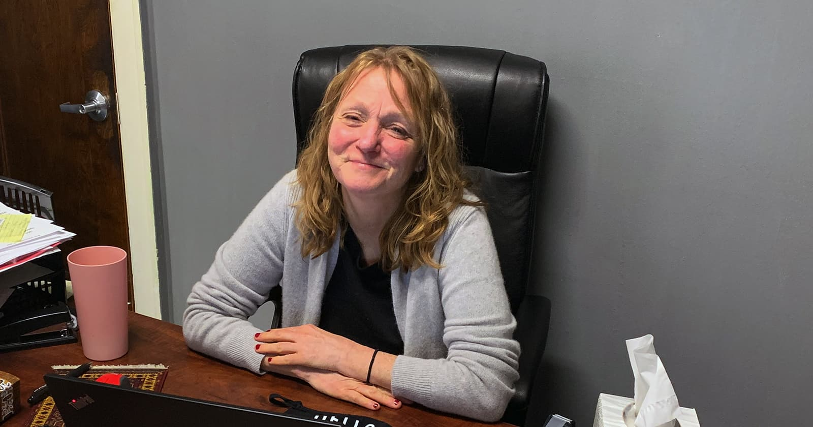Kris Rittenmeyer sitting at desk in her office